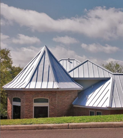 A residential metal roof on a brick home in Beaumont.